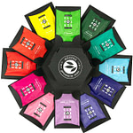 alveus Gimmick Giftbox Geschenkbox Tester-Box entwickelt designed und als Serienprodukt realisiert von LangeArchitekten aus schwarzer Pappe und weißem UV-Lack aufgeklappt sehr dekorativ als Fächer der 12 bunten alveus Elements-Teebeutel mit einem alveus-Doppelwandglas in der Mitte das perfekte Geschenk