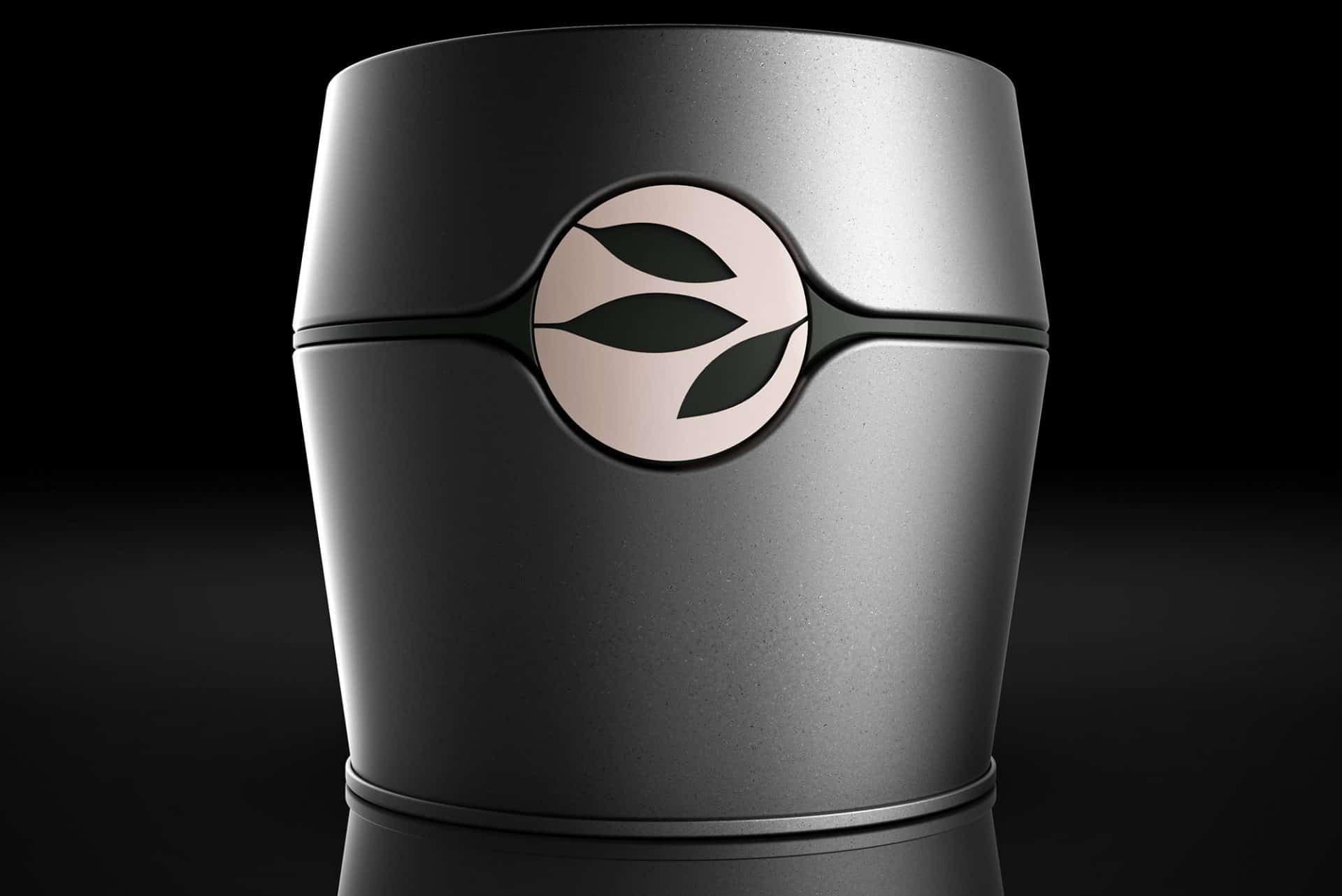 alveus premium-teas Brand Caddy Teedose für 100 Gramm losen Tee mit Aroma-Schutz und Logo Relief als markantes Element gunmetal mit schwarzen Akzenten für alveus Tea-Stores weltweit designed und als Serienprodukt entwickelt von Lange Architekten